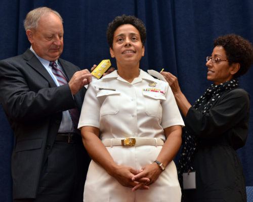 Vice Adm. Michelle Janine Howard, center, has her shoulder boards replaced by her husband, Wayne Cowles and her sister, Lisa Teitleman, during a promotion ceremony at Naval Support Activity Hampton Roads. Howard is the first African-American woman to receive a third star in flag rank.  She assumes the duties as deputy commander of U.S. Fleet Forces Command and commander of Task Force 20. (U.S. Navy photo by Mass Communication Specialist 1st Class Rafael Martie/Released)
