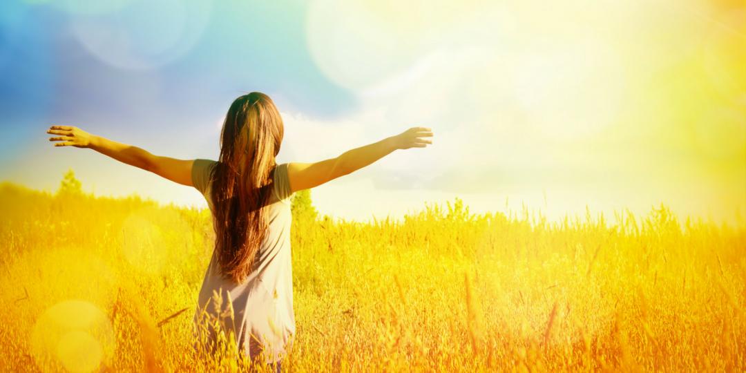 woman-enjoying-sun-in-open-field